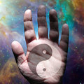 Yin yang human hand and deep space Royalty Free Stock Photography