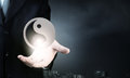 Yin yang phylosophy close up of businessman holding symbols in palm Stock Photography