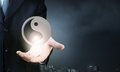 Yin yang phylosophy close up of businessman holding symbols in palm Royalty Free Stock Photos