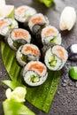 Yin yang roll maki sushi made of fresh salmon and cucumber inside nori outside Stock Images
