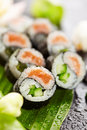 Yin yang roll maki sushi made of fresh salmon and cucumber inside nori outside Stock Photos