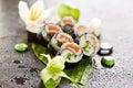 Yin yang roll maki sushi made of fresh salmon and cucumber inside nori outside Stock Photo
