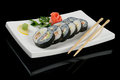 Yin yang rolls served on plate with chopsticks Stock Image