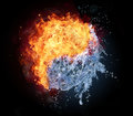 Yin yang symbol made of water and fire on black background Royalty Free Stock Photography