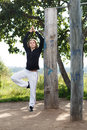 Yoga asana pose young woman making outdoors in the park Royalty Free Stock Photo