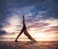 Yoga on the beach man doing near ocean in india Stock Images