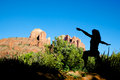 Yoga at cathedral rock a woman silhouetted in a pose near scenic sedona arizona Stock Photo