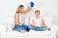 Yoga for children boy sitting on the couch and meditating girl in boxing gloves wants to wake him up Royalty Free Stock Image