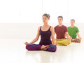 Yoga classes three young people a women and two men practice class stand in line Stock Images