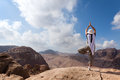 Yoga in the desert woman is standing tree position while hiking through petra Stock Photo