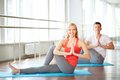 Yoga exercise portrait of young women doing with guy on background Royalty Free Stock Photo