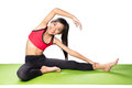 Yoga exercises little asian girl doing fitness isolated over white Royalty Free Stock Photos