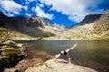 Yoga exercising in tatry mountains exercise everywhere slovakian beautiful panorama chata teryho kotlina piatich spisskych plies Stock Photo