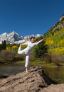 Yoga in fall a woman practicing the scenic colorado mountains Stock Photo