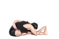 Yoga forward bending pose janu sirsasana by indian man in black costume isolated at white background Stock Images