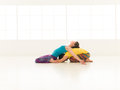 Yoga gym vibrant color two people a men and a women doing partners in a white Stock Image