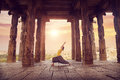 Yoga in hampi temple woman doing ruined ancient with columns karnataka india Royalty Free Stock Photography