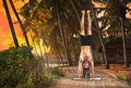 Yoga handstand pose at sunset Stock Photos