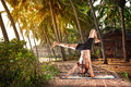 Yoga handstand pose in tropic Royalty Free Stock Image