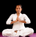 Yoga indian teen girl doing namaskaram on black background Royalty Free Stock Photo