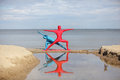 Yoga in kaleidoscope at the beach couple anonymous colorful costumes Royalty Free Stock Photo