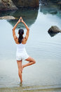 Yoga lifestyle woman beach doing pose at the ocean for zen health and peaceful Royalty Free Stock Photography