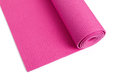 Yoga mat pink with white background Royalty Free Stock Images