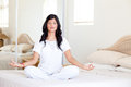 Yoga meditation on bed Stock Photography