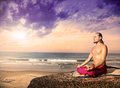 Yoga meditation near the ocean Royalty Free Stock Photo