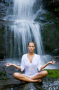 Yoga meditation near waterfall Royalty Free Stock Photo