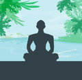 Yoga meditation silhouette by man at palms ocean and sunset sky background Stock Photos