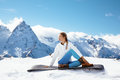 Yoga on mountain in winter Royalty Free Stock Photo