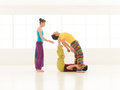Yoga partner gym vibrant color people dressed in colors perform moves inside Royalty Free Stock Images