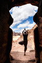 Yoga in petra woman tree position the doorway of an ancient tomb jordan Royalty Free Stock Photo