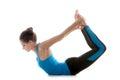 Yoga pose dhanurasana sporty girl on white background in bow urdva chakrasana upward wheel Royalty Free Stock Images