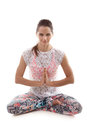 Yoga pose sukhasana girl on white background in easy decent pleasant vertical Royalty Free Stock Photo
