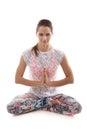 Yoga pose sukhasana girl on white background in easy decent pleasant vertical Royalty Free Stock Photo