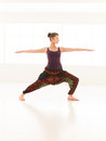 Yoga pose variation demonstrated by young female instructor single woman in dressed colorful in studio light and reflection Stock Images