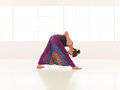 Yoga posture demonstration by young female instructor woman practicing with face obscured indor shot Royalty Free Stock Photos
