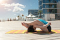 Yoga postures with twisting against Royalty Free Stock Photo