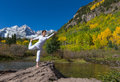 Yoga practice in fall a woman practicing the scenic colorado mountains Royalty Free Stock Photos