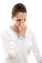 Yoga practice nadi shodhana pranayama girl on white background practicing alternate nostril breathing close up Stock Photo