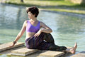 Yoga session beautiful woman doing exercises in a tranquil location Stock Images