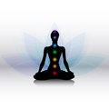 Yoga silhouette with chakras human in pose Stock Image