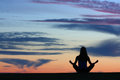 Yoga silhouette of woman practicing outdoors Royalty Free Stock Photos