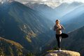 Yoga at summit with aerial view of the mountain range and peak blue sky Stock Photography