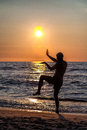 Yoga on the sunny beach man excercising at sunset Royalty Free Stock Images