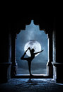 Yoga in temple at night man silhouette doing old full moon sky background Royalty Free Stock Photos
