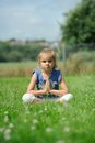 Yoga time a little girl sitting on the grass doing Royalty Free Stock Photography