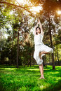 Yoga tree pose in the park Stock Photos
